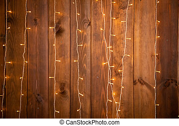 Christmas lights garland on a old wooden background