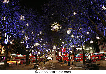 Christmas Lights Display on Sloane Square in Chelsea, London. The modern colourful Christmas lights attract and encourage people to the street.