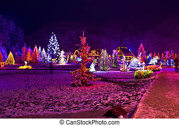 Christmas lights in town park - fantasy colors