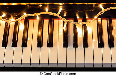 Christmas lights on a piano keyboard, above view