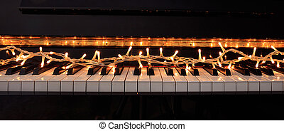 Christmas lights on a piano keyboard, front view