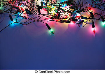 Christmas lights on dark blue background with copy space. ...