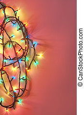 Christmas lights on dark pink background