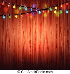Christmas lights on wood background