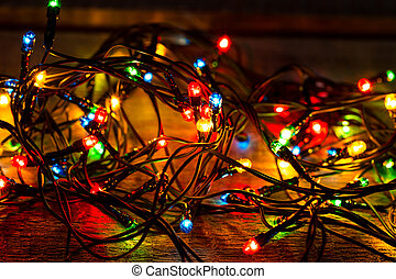 Christmas lights on wood background