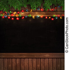 Christmas holiday lights on wooden blackboard