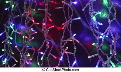 Christmas lights over dark background. Close up shot.