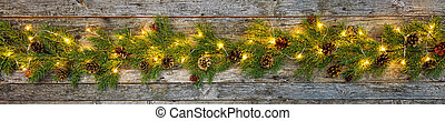 Christmas lights with decoration on wood