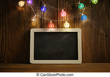 Christmas lights with slate blackboard