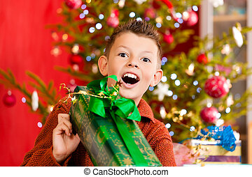 Christmas - little boy with Xmas present