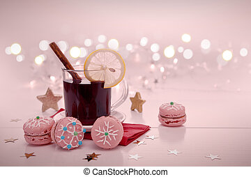 Christmas macaroons and mulled wine isolated on blur background.