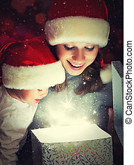 Christmas magic gift box and a woman happy family mother and Child baby