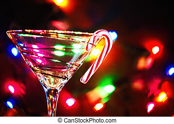 Christmas martini - Martini glass with candy cane and bokeh...