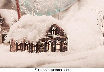 Christmas miniature house with snow.