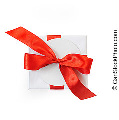 Christmas mockup Gift box wrapped in paper and with a red bow isolated on white background, clipping path included