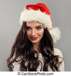Christmas Model Woman wearing Santa Claus Hat, Beauty Fashion Portrait