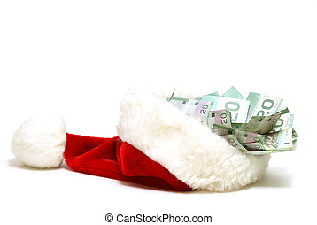A financial concept for the holidays using a santa hat and some money.