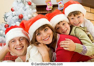 Christmas mood - Portrait of happy family in Santa caps
