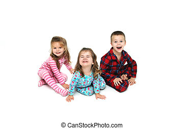 Christmas Morning Surprise - Three children react with...