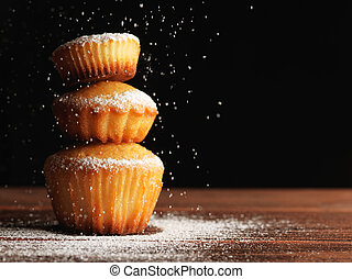 Christmas muffins covered powdered sugar, (background for congratulations)
