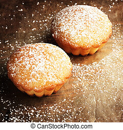 Christmas muffins covered powdered sugar, (background for ...
