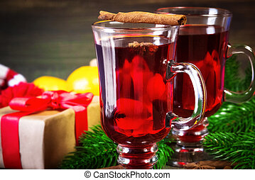 Christmas mulled wine with cinnamon sticks