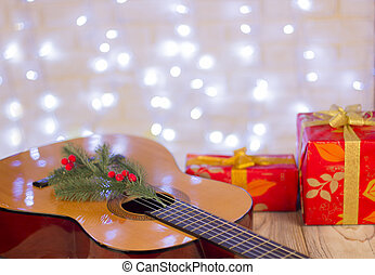 Christmas music background.Guitar and red gifts