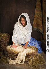 Christmas nativity baby - Teenager girl playing the role of...