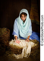 Christmas nativity scene with doll - Teenager girl playing...
