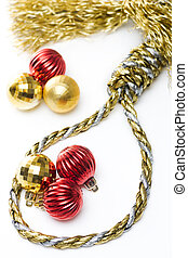 Noose made out of christmas rope, with baubles in the background, isolated on white.