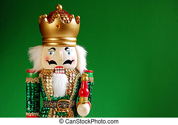 Christmas nutcracker on green background