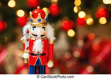 Christmas nutcracker with Christmas tree bokeh background