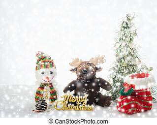 Christmas object with snow falling on white