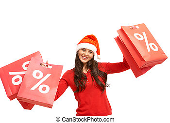 Christmas offer - Happy girl in Santa cap holds red ...