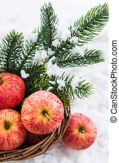Christmas ?omposition with red apples and branch of christmas t