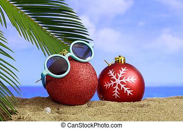 Christmas on a sandy beach - Christmas balls and sunglasses...
