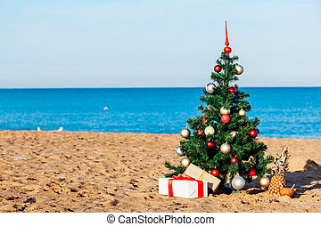Christmas on the beach with gifts new year