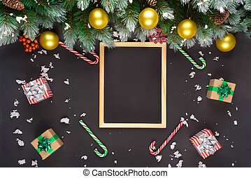 Christmas or New Year black wooden background, Xmas black board framed with season decorations, space for a text, view from above