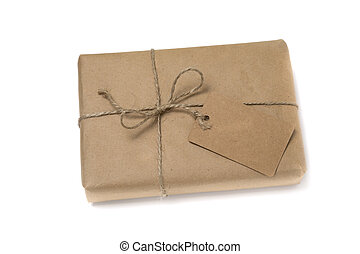 Christmas or New Year gift box wrapped in kraft paper with blank gift tag.