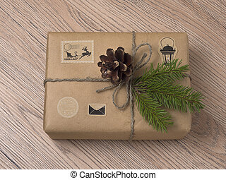 Christmas or New Year gift boxes wrapped in kraft paper with fir branch.