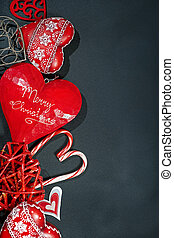 Christmas or New year ornaments in red color on dark background, top view. Holiday d?cor concept. Flat lay, vertical composition with copy space