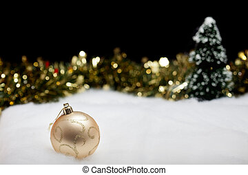 Christmas ornament bauble in sparkling winter forest
