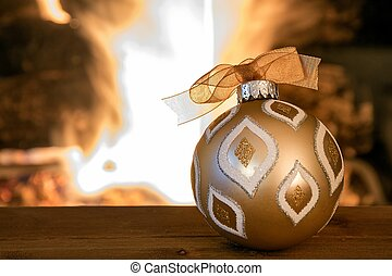 Christmas ornament by fireplace