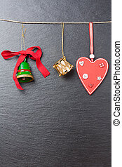 Christmas ornament: green bell, golden drum and red heart