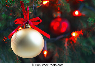 Christmas Ornament with Lighted Tree in Background, Copy Space