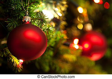Christmas Ornament with Lighted Tree in Background, Copy ...