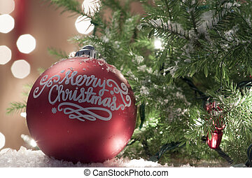 Christmas Ornament with Lighted Tree in Background