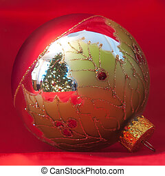 christmas ornament with tree reflection