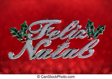 """Christmas ornament wrote """"Merry Christmas"""" greeting in portuguese isolated on red defocused background"""