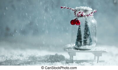 Christmas ornaments and falling snow - Christmas ornaments...